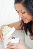 Close-up of a woman looking in an open gift box