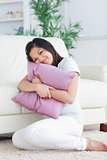 Woman holding tight a pillow