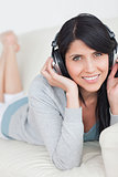 Woman smiling and wearing headphones