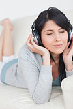 Woman closing her eyes while wearing headphones