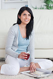 Woman smiling while holding a glass of red wine