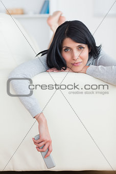 Woman on a sofa holding a remote