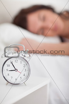 Alarm clock being placed on a bedside table
