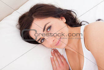 Calm brunette woman waking up in the morning