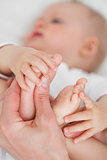 Hands touching the feet of a baby