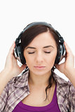 Woman with headphones enjoying music the eyes closed