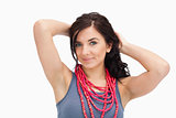 Brunette wearing a red bead necklace