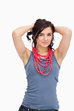 Brunette posing with a red bead necklace