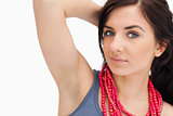 Blue eyed woman posing with a red bead necklace