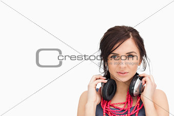 beautiful student with headphones around her neck