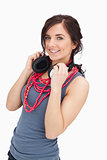 Smiling student holding her headphones