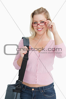 Smiling blonde woman wearing red glasses