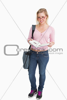 Blonde woman opening an interesting book