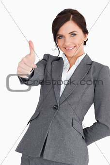 Beautiful young businesswoman the thumb-up