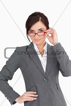 Beautiful young businesswoman holding her glasses