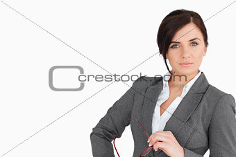 Attractive business woman holding glasses