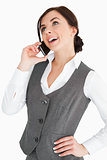 Happy well-dressed woman calling with a smartphone