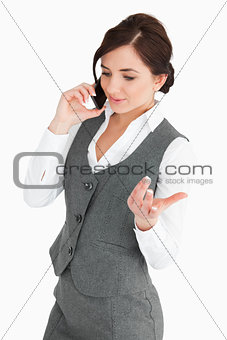 Attractive woman in suit speaking through the phone