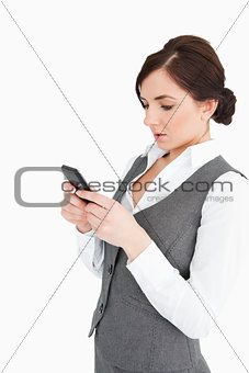 Attractive woman text-messaging