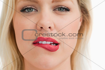 Attractive blonde woman biting her lips