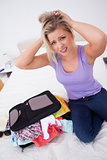 Blonde having problem to close her suitcase