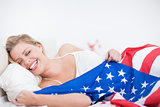 Laughing blonde woman with a US flag