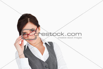 Beautiful businesswoman holding her glasses
