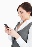 Attractive businesswoman text-messaging