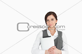 Beautiful businesswoman holding a tactile tablet