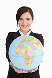 Brunette businesswoman holding an earth globe