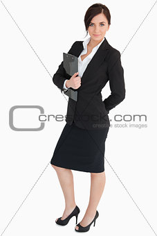 Attractive businesswoman holding a clipboard