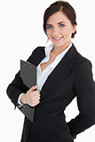 Happy businesswoman holding a clipboard