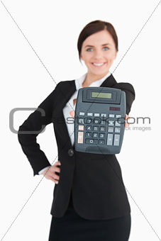 Happy businesswoman in black suit showing a calculator
