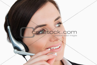 Woman in suit using a headset