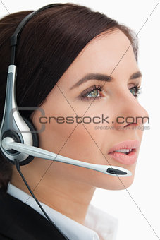 Green eyed businesswoman speaking in a headset