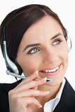 Pretty businesswoman using a headset