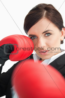 Beautiful woman boxing with red gloves