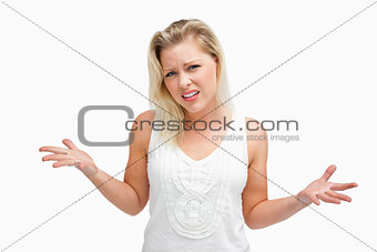 Upset woman standing while extending her arms