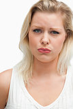 Upset blonde woman seriously looking at the camera