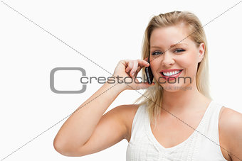 Smiling blonde woman holding a cellphone
