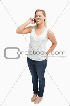 Smiling blonde woman holding her mobile phone