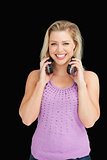 Smiling blonde woman holding her headphones