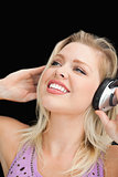 Joyful blonde woman listening to music
