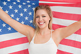 Smiling woman raising the American flag