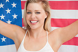 Cheerful woman holding the American flag