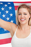 Smiling woman holding the Old Glory flag