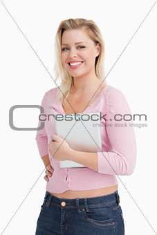 Attractive woman proudly holding her tablet computer