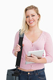 Happy blonde woman holding a shoulder bag