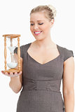 Woman looking a hourglass on her hand