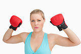 Woman showing boxing gloves